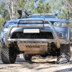 Triton 4×4 driving with underbody protection