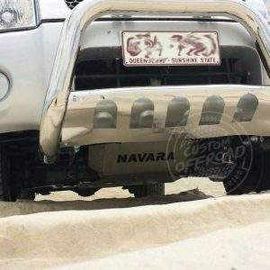 Nissan Navara D22 4x4 driving on sand with bash plates fitted by Custom Offroad Accessories